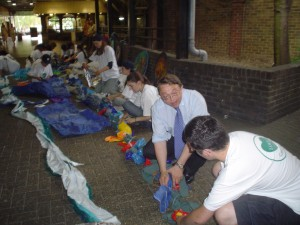 MP Paul Clark working with volunteers from St mark's church to make the mall art project.